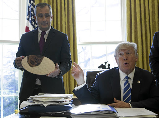US President Donald Trump speaks while Intel CEO Brian Krzanich listens during a meeting at The White House in Washington. Picture: BLOOMBERG