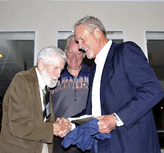 Photo: Barry and Gerry present Orion with his t-shirt and poetry book