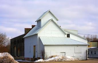Photo: Stark white factory building