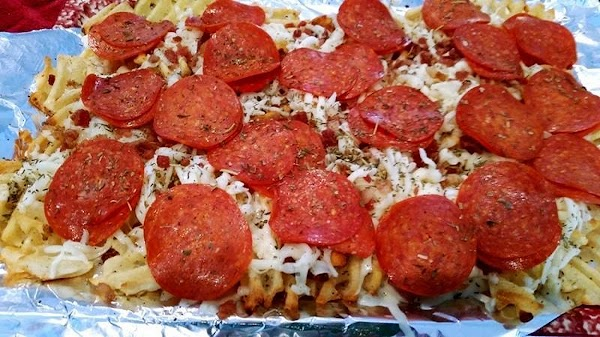 Turn oven to broil.  Remove from oven and spread cheese evenly over fries. I then...