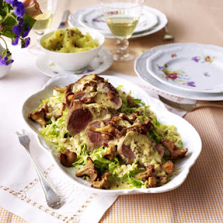 Baked Pork Loin with Green Cabbage and Chantarelle Cream Sauce.
