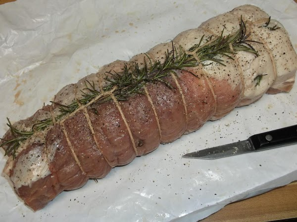 Thread a stem of rosemary under the twine down the center of one or...