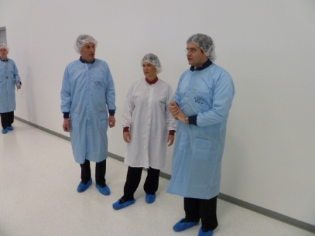 Photo: Waltl, von Trapp and Lindner survey the new clean manufacturing space.