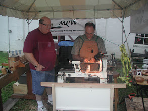 Photo: Pat McVicker practicing the pen-turning tips with Carl Powell observing
