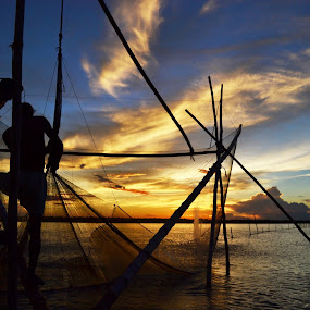 FISHING AT SUNSET 4 by Dipankar Singha - Landscapes Sunsets & Sunrises