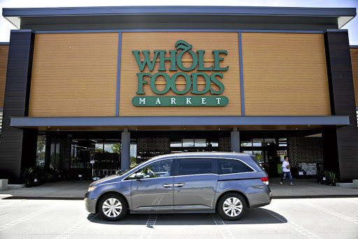 Price war: A car passes in front of a Whole Foods Market store in Illinois, US. Amazon now has control of more than 460 of the group's stores. Picture: BLOOMBERG