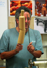 Photo: Here Mark explains the multi-axis nature of the rolling pin.