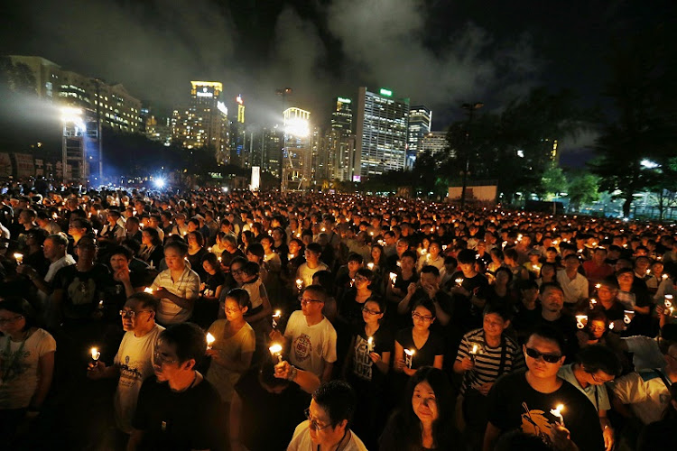 Tens of thousands of people take part in a candlelight vigil at Hong Kong's Victoria Park in June 2014, to mark the 25th anniversary of the military crackdown on the pro-democracy movement at Beijing's Tiananmen Square in 1989.  File picture: REUTERS