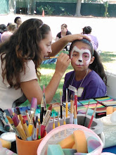 Photo: Maria face painting a puppy at a company picnic in the park in Chino Hills, Ca. Call to book her for your company picnic today! 888-750-7024 http://www.memorableevententertainment.com/FacePainting/MariaChino,Ca.aspx
