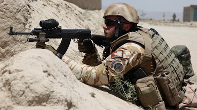 Photo: A Czech Republic soldier provides security in the village of Baraki Barak, Logar province, Afghanistan, during route clearance, in order to improve security in the area, July 06, 2011.