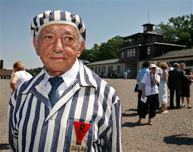 Photo: Nazi concentration camp survivor Emil Alperin from Ukraine stands in front of the entrance of the former Nazi concentration camp Buchenwald near Weimar, Germany, Sunday, July 15, 2007. The commemoration ceremonies for the 70th anniversary of the construction of the Nazi concentration camp took place this weekend. More than 250.000 people were held captive in the camp between 1937 and 1945, and more than 50.000 of them died during that time. (AP Photo/Jens Meyer)