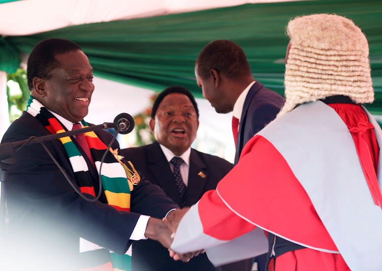 Zimbabwe's President Emmerson Mnangagwa is congratulated by the Chief Justice, Luke Malaba, after taking the oath of office during his presidential inauguration ceremony in Harare.