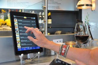 Photo: Bobbi Parisi  of  Portland, Oregon, orders off the menu during lunch at the Oyster Bar at Mimosa, a new restaurant located on Concourse G at the Minneapolis St. Paul airport photographed on September 5, 2012. Parisi who grew up in West St. Paul was on the way to Amsterdam and was intrigued with the use of the Ipads in the restaurant.   (Pioneer Press: Ginger Pinson)