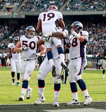 Photo: Royal caught a touchdown pass to become the second Bronco in team history to catch a TD and return a punt for a TD in the same game. Photo by Eric Lars Bakke / Denver Broncos
