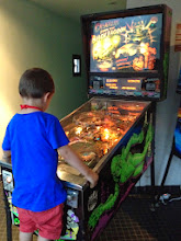 Photo: Free pinball machines. Nuff said. (That's our son playing for the first time. It's now his favorite game ever.)