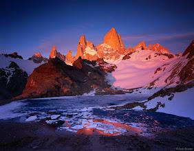 Photo: Brilliant sunrise alpenglow on Chaltén (aka Monte Fitz Roy) and Cerro Poincenot, as seen from Laguna de los Tres. Parque Nacional los Glaciares, Argentina - November.