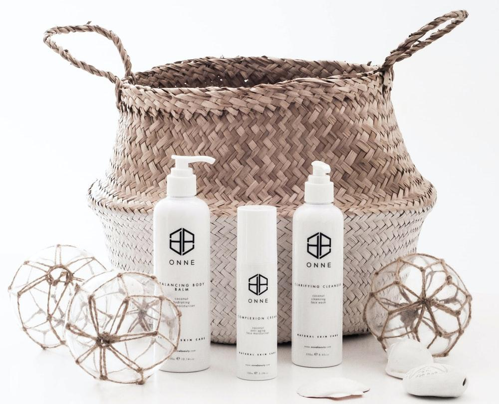 white Onne bottles and brown basket