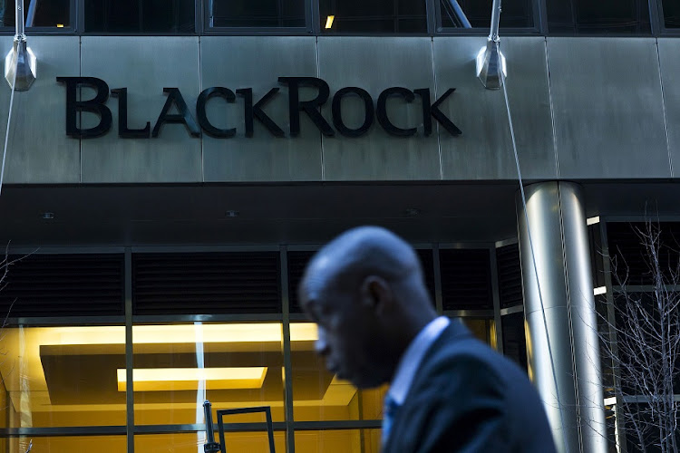 A man walks next to a BlackRock sign pictured in the Manhattan borough of New York. Picture: REUTERS/EDUARDO MUNOZ