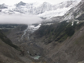 Photo: low clouds hover over glacial waterfalls and pools