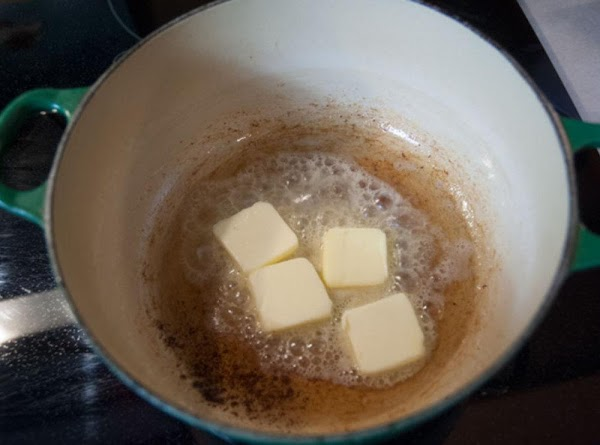 Add the butter to the pot, and melt the butter, until the foaming subsides.