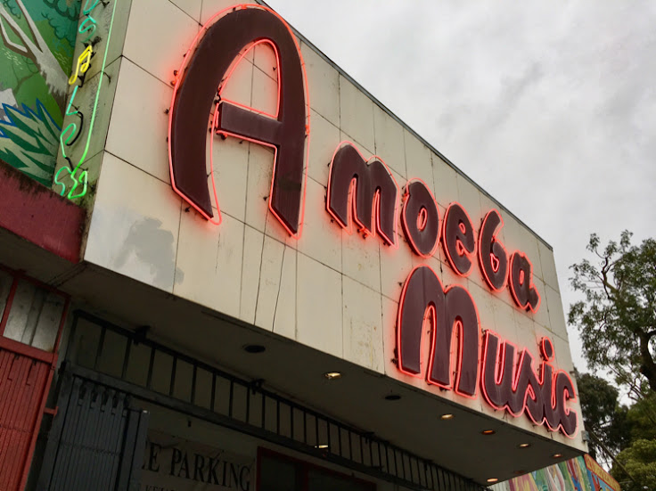 The classic neon sign above the entrance to Amoeba Music.