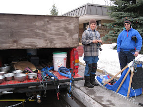 Photo: Jim and Dwayne examining headlamps, straps, sled.