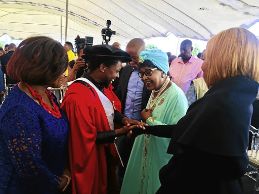 Dr Mbuyiseni Ndlozi welcomes Winnie Madikizela-Mandela and her entourage to his graduation party in Orange Farm on Sunday. EFF leader Julius Malema is standing between them. / supplied