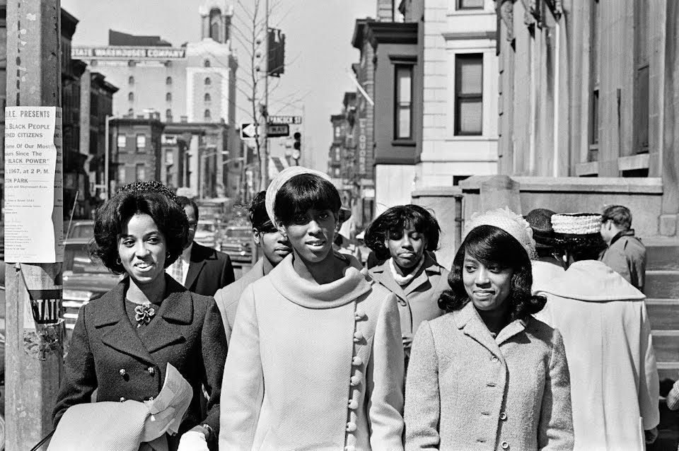 Photograph of a group of women walking down the street in the Bedford-Stuyvesant neighborhood in the 1960s