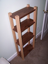 Photo: Small bookcase.  My daughter needed a bookcase for her small appartment.  Walnut and maple.  24 inches wide, 9 inches deep, and 48 inches high.