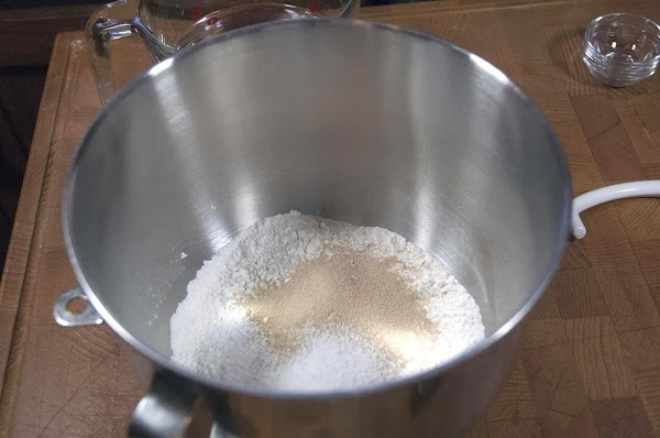 Add the flour, yeast, and the salt to the bowl of a stand mixer.
