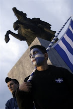 Photo: A boy holds a Greek flag in front of the statue of Alexander the Great , during a rally against a compromise on a dispute with Macedonia, in the northern Greek city of Thessaloniki on Wednesday, March 5 ,2008. The two Balkan countries are engaged in UN -mediated talks over Macedonia's name. Greece argues that its northern neighbor's use of the name Macedonia could imply territorial claims on the Greek province of Macedonia. The leader of a nationalist party and the city's Orthodox bishop will address the rallies. (AP Photo/Nikolas Giakoumidis)