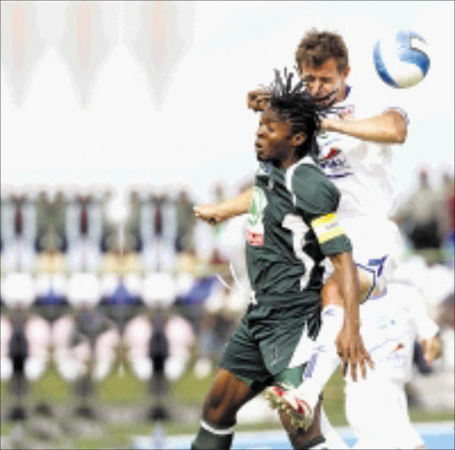 HEADS YOU LOSE: Glen Salmon of SuperSport United  beats Bukasa Kasonga of AmaZulu in an aerial challenge. Pic. Gavin Barker. 19/10/2008. © Backpagepix.