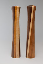 "Photo: Gary Guenther 2 1/4"" x 12 1/4"" shafted CrushGrind pepper mills [cherry, maple, and walnut laminated by Ed Karch]"