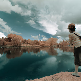 Fishing Fantasy by Richard Amar - City,  Street & Park  City Parks ( clouds, ir, canon eos 20d, infrared, reflections, ethereal, youth, fantasy, false color, canon efs10-22mm f/3.5-4.5 usm, fishing, ir modified camera, boy, jurong lake )