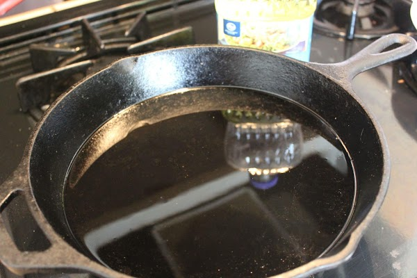 Place oil in skillet about 1/2 inch deep and heat while breading tenderloin.