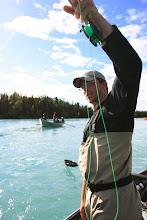 Photo: Nick Ohlrich of Alaska Drift Away Fishing putting the brakes on a Kenai rainbow trout.