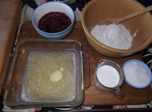"Melt butter in 9"" square pan. In bowl, combine sugar, flour, baking powder and..."