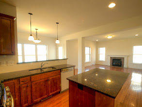 Photo: The kitchen, dining and family rooms in the HAMILTON
