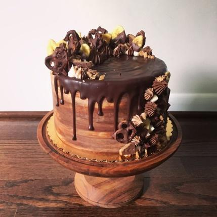 Photo of Good Morning Bakery - Reston, VA, United States. Banana cake with chocolate buttercream and chocolate ganache