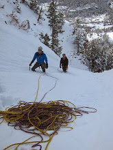 Photo: I lead the first rope length through the deep snow to the base of the ice.