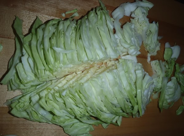 Clean and core cabbage.  Slice in half, and slice down each half again. Cut...
