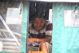 Photo: Year 2 Day 42 -  Tuk Tuk Driver Waiting for a Fare in the Rain on Pub Street