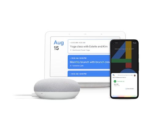 A Google Home, laptop, and phone featuring Hey Google