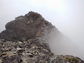 Photo: Looking back at the false summit, with a second team behind.