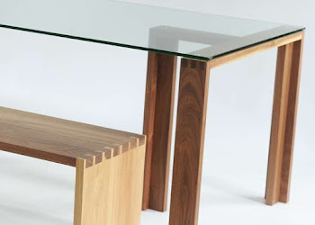 Wooden Bench Next to Glass Table