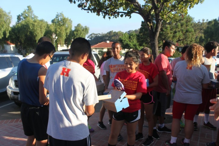 Hawthorne runners receive shoes from Mira Costa