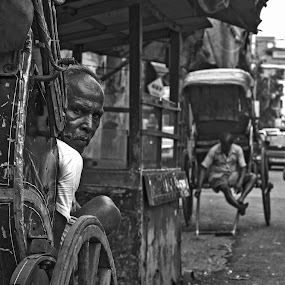 The Rickshaw Puller by Ritwik Ray - City,  Street & Park  Street Scenes ( streetscape, portraits, street scenes, street photo, street photography )