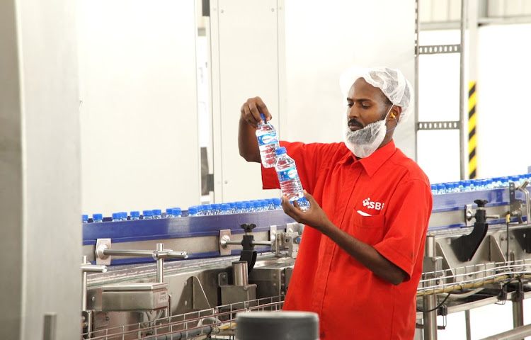 A worker at the SBI water bottling plant in Hargeisa, Somaliland