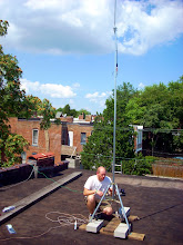 Photo: Wiring up the mast for WasabiNet-bolita, a Ubiquiti Bullet2HP access point with a 12dB dipole.
