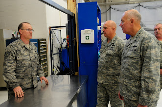 Photo: U.S. Air Force Lt. Gen. Harry Wyatt, Director of the Air National Guard, speaks with Tech. Sgt. Robert Wolf about the state of the art tool accountability system in the aircraft hanger at the 148th Fighter Wing Air National Guard base in Duluth, Minn. Dec. 11th, 2009.  Lt. Gen Wyatt toured the guard base to better understand the facilities and mission capabilities at the wing. (U.S. Air Force photo by Master Sgt. Jason W. Rolfe)